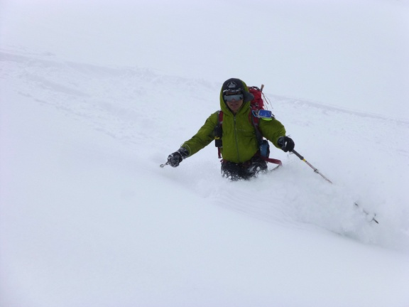 Enjoying powder on the way down