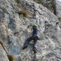 "P1010804.JPG -- A boy climbing on the near-by ""Klettersteig"" Iron-way"