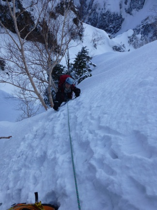 In the early morning steep snow wall