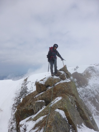 And finally we actually have to climb and crawl over snow covered rock