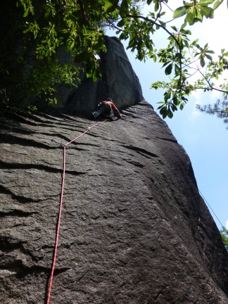 Mr. K climbing in the route 信楽街道 5.10c. A slippery slab followed by some trick crack/layback