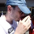 P1030779.JPG -- Jose enjoying a bit of sake from the shrine
