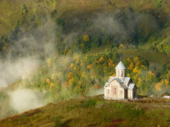 The (uninteresting) church in Gudauri with clouds and colored leafs