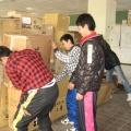 0320 043.jpg -- School kids helping to distribute