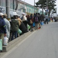 0320 059.jpg -- Lining up for water - the most precious thing