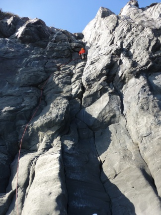 Leading a difficult 10a, all natural protection on Miyakejima
