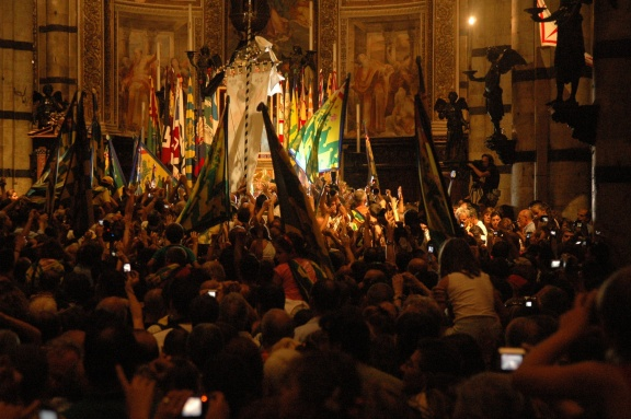 Celebrating the win in the church of the contrada, with horse.