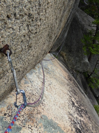 The crux of Selection, a strange traverse with natural pro and a scary old piton at the end.