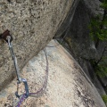 P1000021.JPG -- The crux of Selection, a strange traverse with natural pro and a scary old piton at the end.