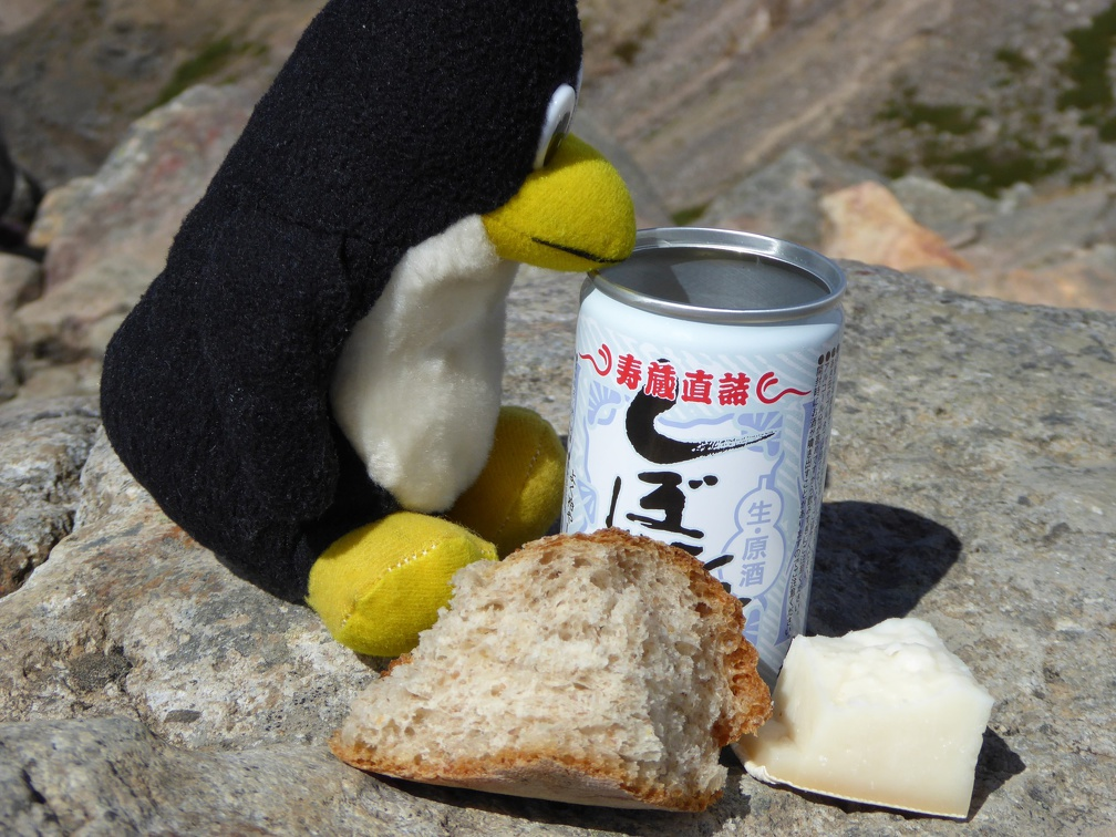 Tux also enjoyed a break with Sake, bread, and cheese!