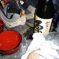 P1000422.JPG -- Scene from the tent: bread, cheese, and excellent sake!