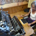 -- The lady master of the shop explains us the book sewing machine