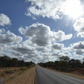 -- Driving north from the lodge, empty streets and wide sky